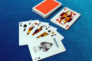The end of a Knock Poker game, with one player holding a royal flush