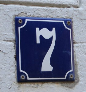 A house number plaque with a 7 on it.