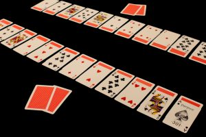 A Turnover Bridge layout, which for each player consists of a row of 12 face up cards atop a row of 12 face down cards.