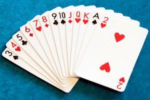 Playing cards in ascending order from 3 up to ace, then a 2
